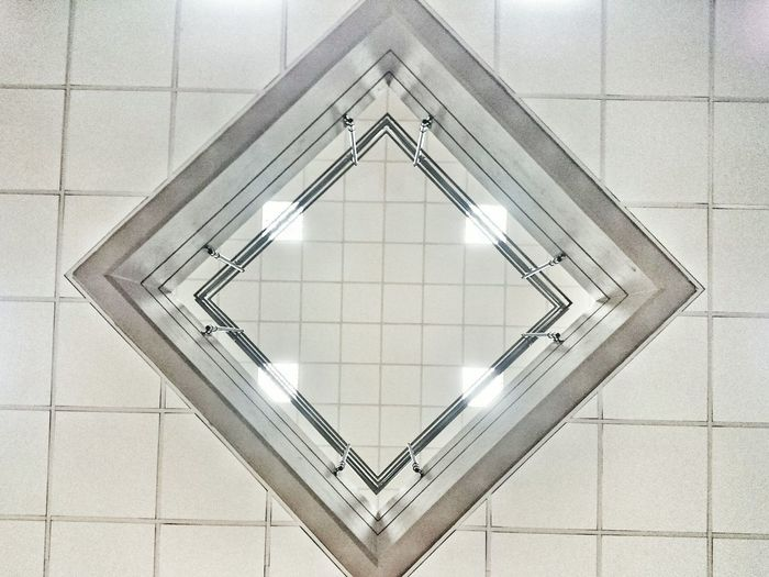 Geometric Shapes Falseceiling VOID Double Height Neonlights Handrail