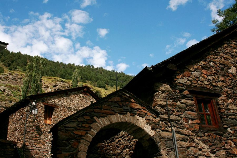 Stone houses in the mountains with blue sky back ground. Architecture Building Exterior Built Structure Cloud - Sky Low Angle View Mountain Mountain Houses Nature Sky Stone Houses  Stone Material Been There.