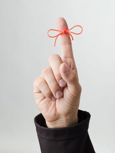 Memorise Close-up Finger Hand Human Finger Human Hand Knot Red Ribbon Red Ribbon Knot Studio Shot