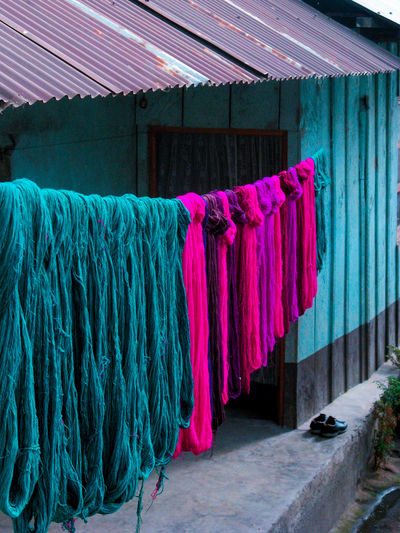 Textiles on rope drying on rope outside house