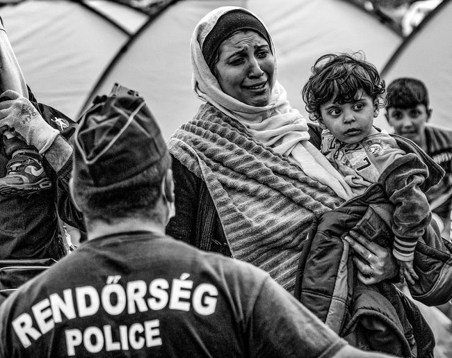 Untold Stories Refugees Helping Refugees Blackandwhite Photography Blackandwhitephotography Eye4photography  Crying Family Police The Photojournalist - 2015 Eyeem Awar