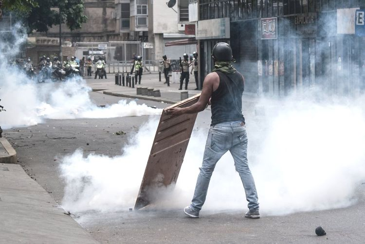 04.20.2017 A demonstrator clashes with the Police in a protest against the government The Photojournalist - 2017 EyeEm Awards