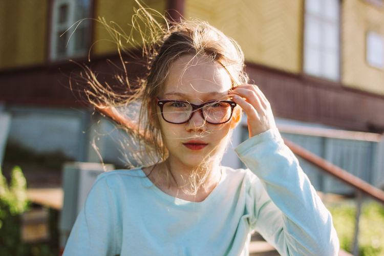 Close-up of girl wearing eyeglasses