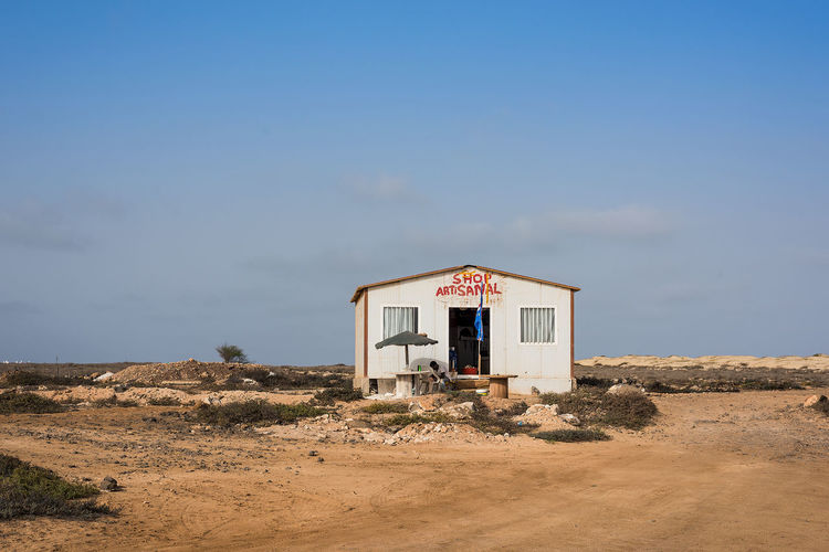 Artisan store on island of Sal in Cape Verde Cape Verde Rural Rustic Africa Architecture Arid Arid Climate Blue Building Exterior Built Structure Day Island Nature No People Outdoors Sand Sand Dune Shop Sky