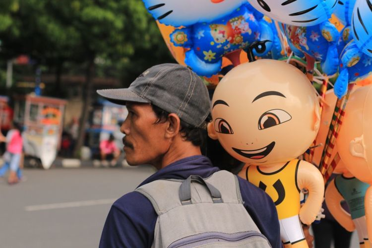 Close-up of man with balloons