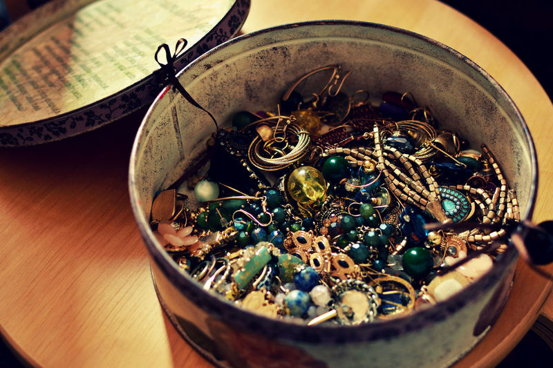 Close-Up High Angle View Of Jewelry In Container