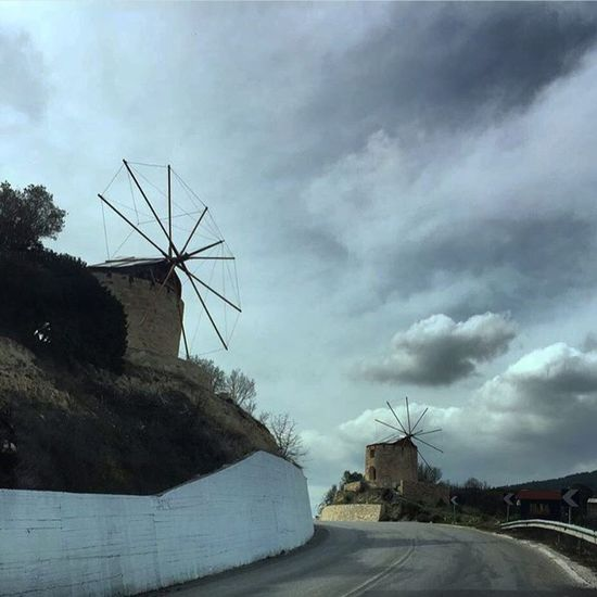 Alternative Energy Wind Power Fuel And Power Generation Wind Turbine Environmental Conservation Windmill Cloud - Sky Sky Day Weather Outdoors Technology No People Industrial Windmill Built Structure Traditional Windmill Road Nature Tree