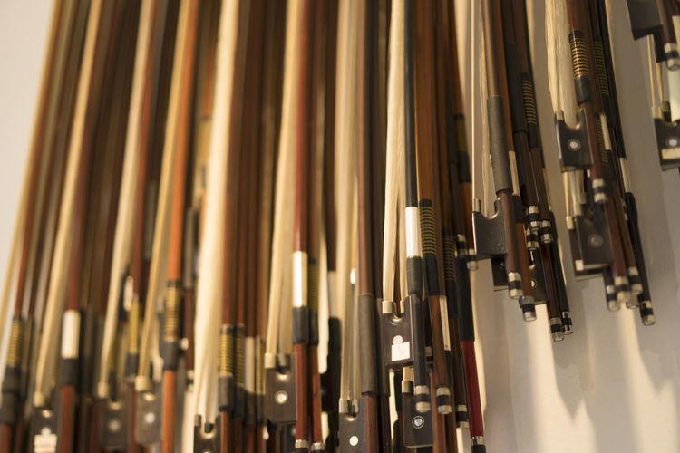 Rows of Hanging Violin Bows Bow Hair Horse Instrument Mane Music Musical Musician Row Stacks  Violin