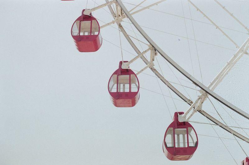 Close-up of amusement park ride against sky