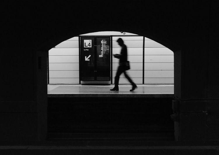Woman walking in bus