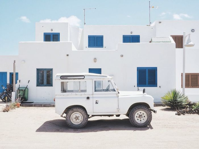 Total white Whitesand Landrover  Defender Lagraciosa Building Exterior Architecture Built Structure Building Transportation Residential District Land Vehicle Day Mode Of Transportation House Window Motor Vehicle No People White Color Nature Sunlight Outdoors Street Car City
