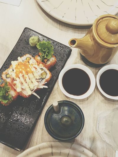 High Angle View Of Sushi And Soy Sauce On Plate