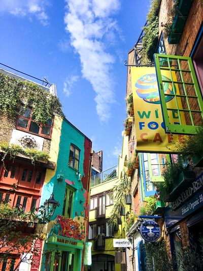 Neals Yard London EyeEmNewHere Blue Sky Neighborhood Neon Colorful Bright Colors Building Covent Garden  Neal's Yard London Architecture Building Exterior Low Angle View Built Structure Text Sky Day Outdoors City EyeEmNewHere