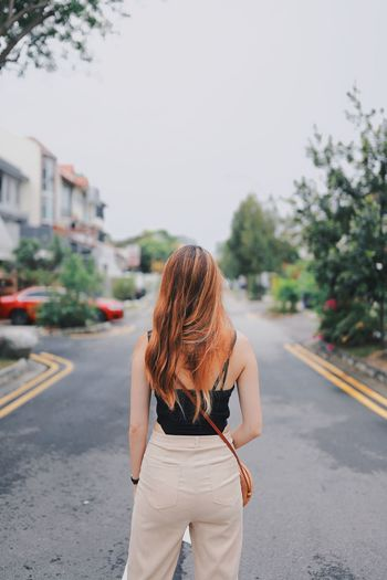 My Best Photo Exploring Fun Singapore One Person City Rear View Road Street Transportation Three Quarter Length Real People Long Hair Hair Standing Hairstyle Women Focus On Foreground Day Lifestyles Leisure Activity Architecture Adult Outdoors