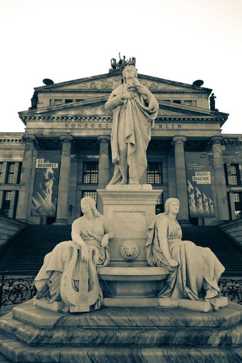 Gendarmenmarkt Architecture Art And Craft Building Exterior Built Structure Clear Sky Craft Creativity Female Likeness History Human Representation Low Angle View Male Likeness No People Representation Sculpture Sky Statue The Past Tourism Travel Destinations