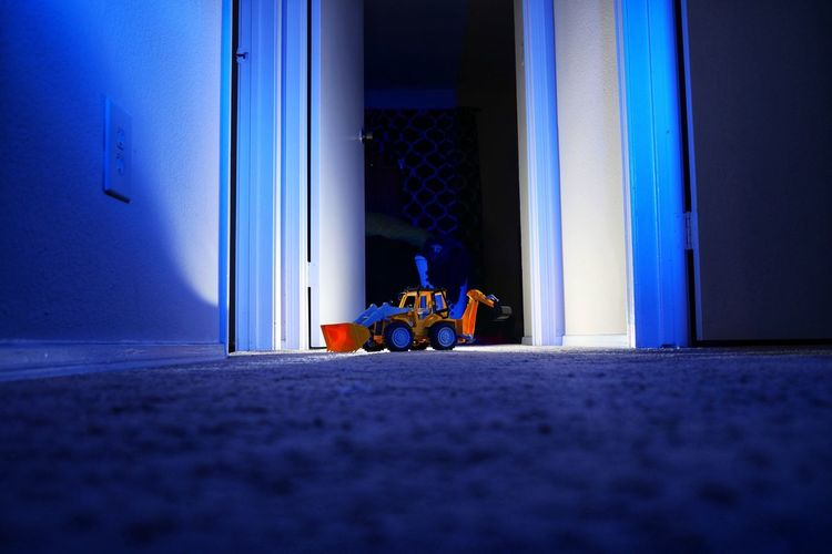 Toy Bulldozer On Rug At Home