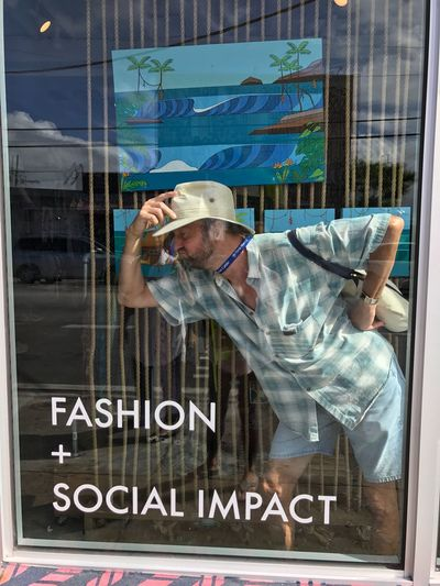 Social Impact Fashion Glass - Material Text Reflection Window Store Window Store Fashion Stories Casual Clothing Retail  Real People Day One Person People Building Exterior Lifestyles