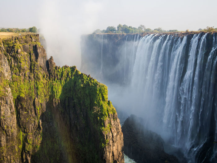 Scenic view of victoria falls waterfall at border between zambia and zimbabwe