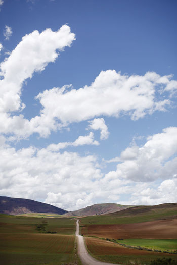Cloud - Sky Landscape Environment Sky Land Field Scenics - Nature Day Nature Tranquility Tranquil Scene Beauty In Nature Road Non-urban Scene Transportation Rural Scene No People Direction Grass The Way Forward Outdoors Peru