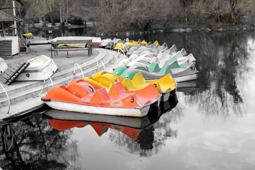 Color boats on black and white lake Black Kayak Lake Multi Colored Nautical Vessel No People Outdoors Pedal Boat Transportation Water Waterfront