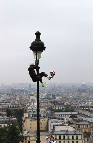 a football artist makes a show at Montmartre, Paris, France Artist Artistic Ball Capital Cities  City Life Cityscape Football Football Fever France Fun Lantern Montmartre Paris Public Publikum Show Silhouette Sport Stage Travel Destinations