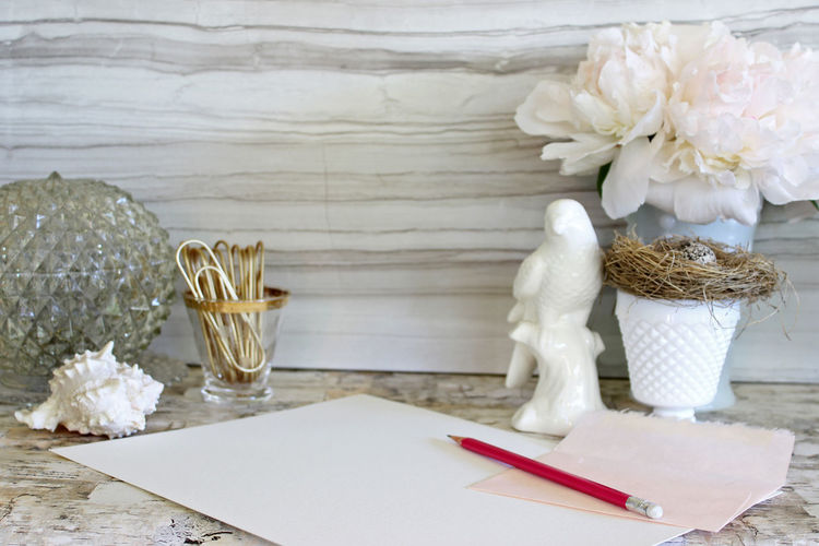 Pencil and white paper by decoration on table