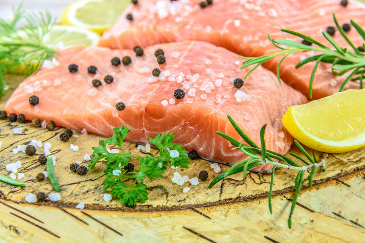 Fresh and aromatic salmon. Fresh salmon steak on wooden birch stump pickled lemon, pepper, sea salt, rosemary, parsley, dill. Aromatic Chef Die Fillet Fish Fishing Her Lemon Norway Ocean Omega 3 Parsley Picle Restaurant Rosemary Salmon Salt Sea Silhouette Steak Stem Studio Shot Traditional Water