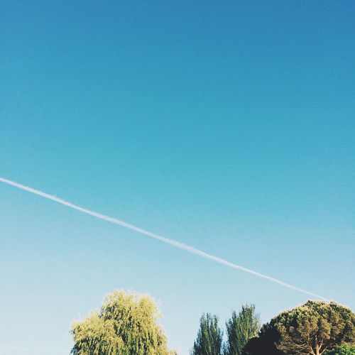 Low Angle View Of Vapor Trail In Clear Sky