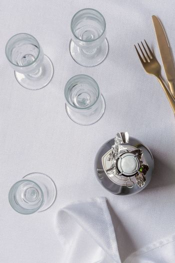 Getting ready to celebrate Champagne Bubbly Stemware Empty Classy Sophisticated Top View Directly Above White Linen Table
