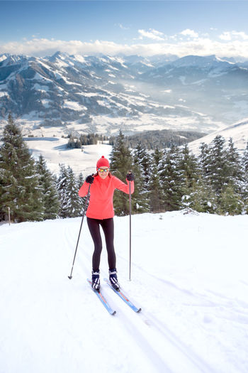 A woman cross-country skiing in the Alps Action, Activity, Adult, Competition, Cross-country, Female, Fit, Fitness, Forest, Healthy, Holidays, Langlauf, Lifestyles, Nordic, People, Running, Skating, Skiing, Snow, Sports, Style, Training, Winter, Woman Adult Beauty In Nature Cold Temperature Day Freedom Full Length Leisure Activity Lifestyles Mountain Mountain Range Nature One Person Outdoors Real People Scenics - Nature Ski Pole Ski-wear Skiing Snow Snowcapped Mountain Sport Warm Clothing Winter Winter Sport