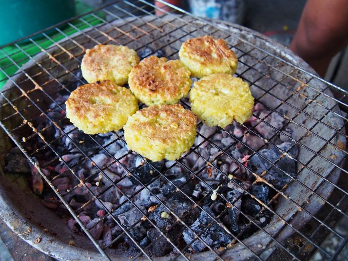 Grilled sticky rice ball on metal grate Thai local snack. Food Heat - Temperature Barbecue Grill Grid Metal Preparing Food Outdoors Grilled Rice Ball Retail  Grate Metal Grate High Angle View Preparation  Temptation Focus On Foreground Food And Drink Freshness Snack Thai Local Food