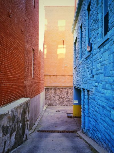 shadow play on city buildings Architecture Built Structure No People Building Exterior Day Outdoors Brick Wall Stone Wall Light And Shadow Warm And Cool Contrast The Way Forward Between Buildings Leading Lines The Architect - 2017 EyeEm Awards BYOPaper! Color Block The EyeEm Collection The Premium Collection Paint The Town Yellow