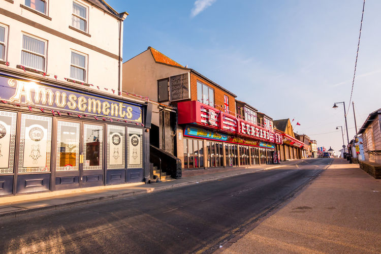 Whitby Whitby Harbour Whitby View Whitby North Yorkshire North Yorkshire Seaside Seaside Town Yorkshire Coast Tourist Destination Amusement  Building Exterior Architecture Street Day No People Road Cloud - Sky Store Building Outdoors Built Structure Sky City Sign