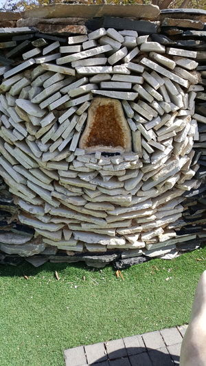 High angle view of stone stack on field in lawn