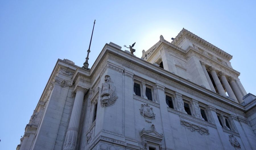Monumento Nazionale A Vittorio Emanuele II Rome Roma Italia Italy Low Angle View Architecture Building Exterior Built Structure Religion Travel Destinations Day Sky Outdoors No People City Blue Sky Sculpture Statue History Your Ticket To Europe