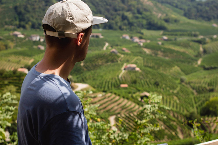 Enjoying The Sun Enjoying The View Green Sunlight View Baseball Cap Cap Field Focus On Foreground Italy Light And Shadow Men One Person Outdoors Prosecco Proseccohills Real People Valdobbiadene Venice Vineyard Wine