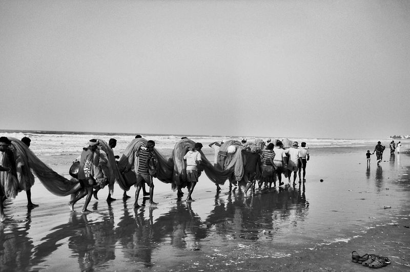 Working together Beach Sea Sand Water Horizon Over Water Sky Outdoors Vacations Nature People Wave Day Fishermen Group Of People Digha India EyeEmNewHere 3XSPUnity Reflection Black & White Black And White Photography Bay Of Bengal The Great Outdoors - 2017 EyeEm Awards