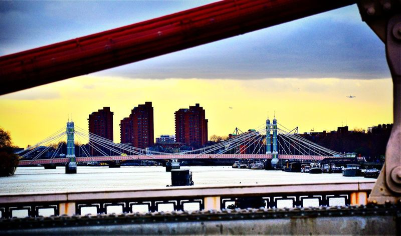 Architecture City Built Structure Sunset Bridge - Man Made Structure Skyscraper River Urban Skyline Sky Water Cityscape Travel Destinations Outdoors No People Suspension Bridge Albertbridge Chelsea Bridge Thames River London_only London Waterfront Londononly Londonthroughmycam LONDON❤