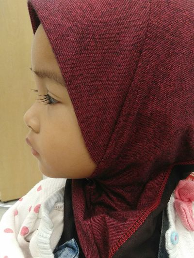 Close-Up Of Cute Girl Wearing Hijab