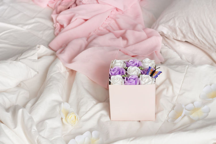 High angle view of flower bouquet on bed