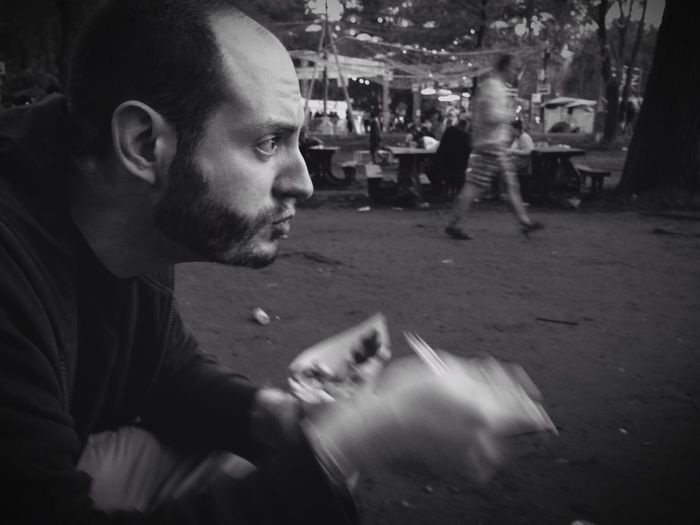 Profile view of man eating snack on street