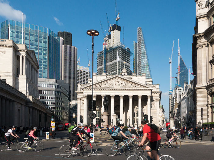Traffic and cyclists at the Bank Of England Bank Of England Cyclist Financial District  Natwest Tower Royal Exchange Architecture Building Building Exterior Built Structure Cheesegrater Building City Cycling Finance Finance And Economy Office Building Exterior Outdoors Real People Road Sky Skyscraper Street Transportation