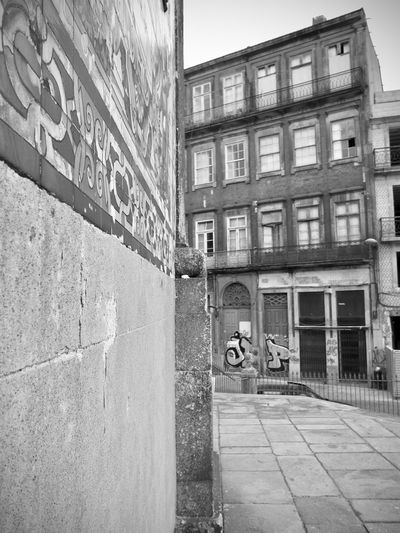 BeW Oporto, Portugal Alley Architecture Black And White Building Building Exterior Built Structure City Communication Day Direction Footpath No People Outdoors Residential District Road Sign Street Text Transportation Wall Wall - Building Feature Window
