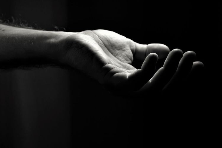 Asking For Help Give Me Your Hand And Let Me Show You My World Low Light A Helping Hand Adult Black Background Close-up Hand Gestures Human Hand Indoors  Indoors  One Person People