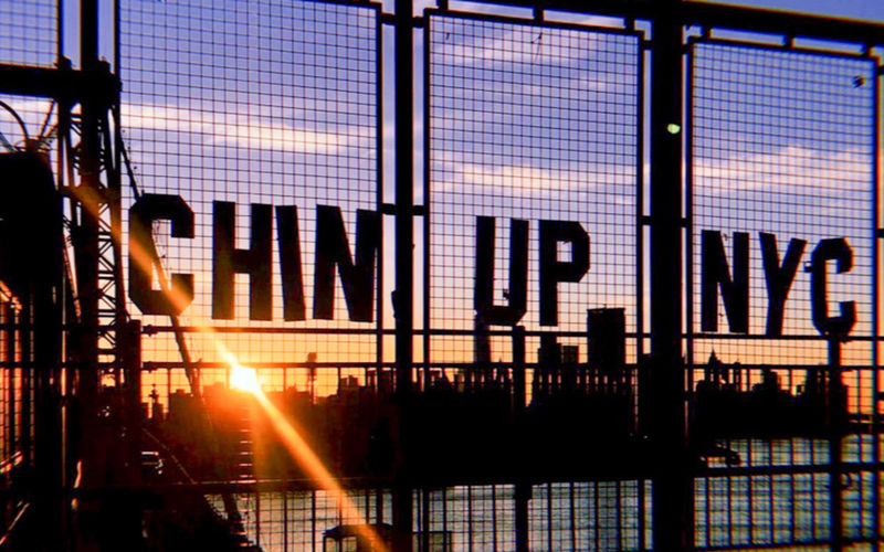 Text on silhouette building against sky during sunset