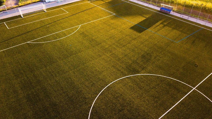 High angle view of empty soccer field during sunset