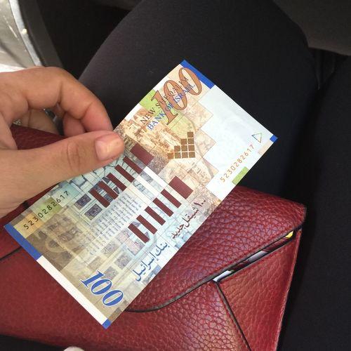 one hundred shekel, money in israel Banknote Finance Holding Human Hand HUNDRED Israel Israeli Money Money Paper Currency Savings Shekel Shekel Money