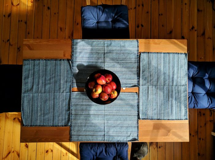 High angle view of fruit bowl standing on table