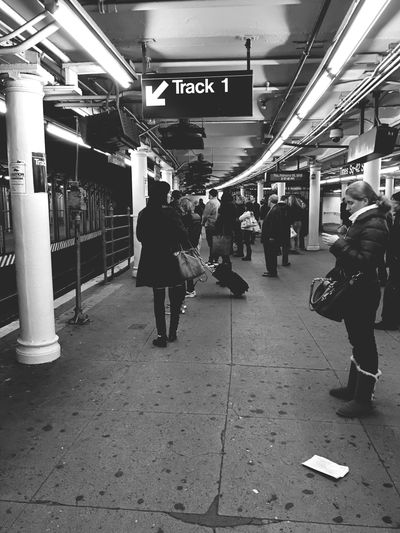 Same old thing as always Grand Central To Times Square Shuttle Train NYC Photography Heading To Work Train Station Blackandwhite Photography NYC
