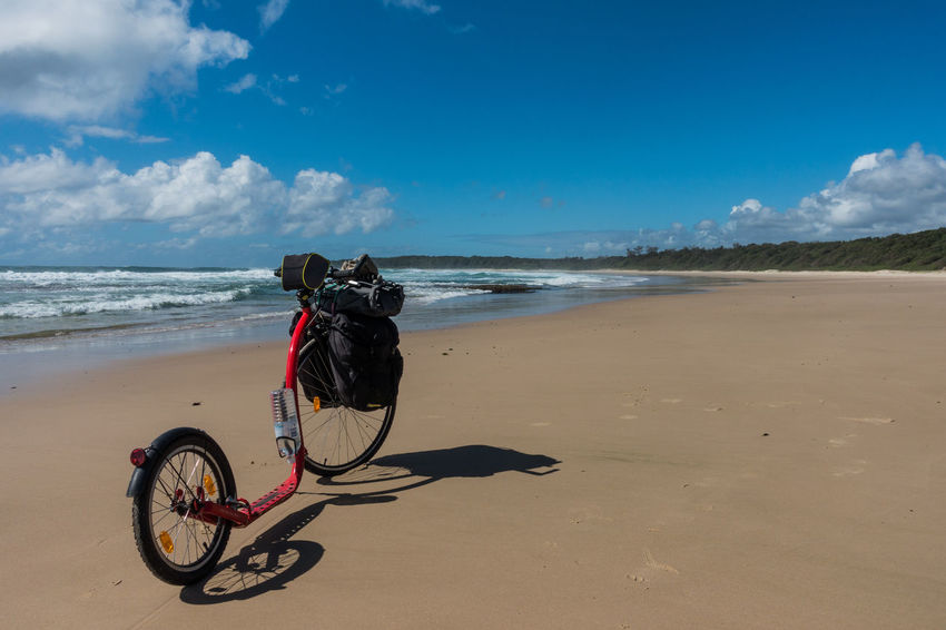 Kickbike on sandy beach with blue sky Beach Bicycle Coastline Escapism Getting Away From It All Horizon Over Water Kickbike Ocean Outdoors Recreational Pursuit Sand Sea Seascape Shore Summer Surf Vacations Water Wave Weekend Activities